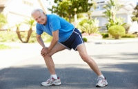 Image of a senior man stretching before a jog