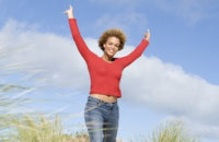 Image of woman holding arms up in victory pose